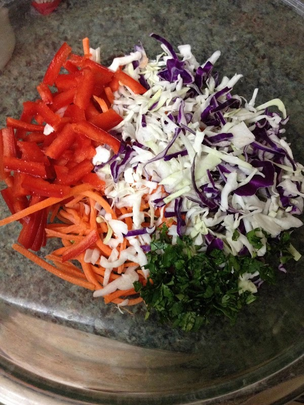 Add in red bell pepper, carrots, cabbage, and cilantro.