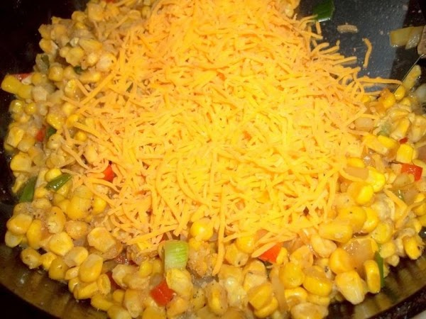 Add the corn & cheese to the onion mixture - salt & pepper. Continue...