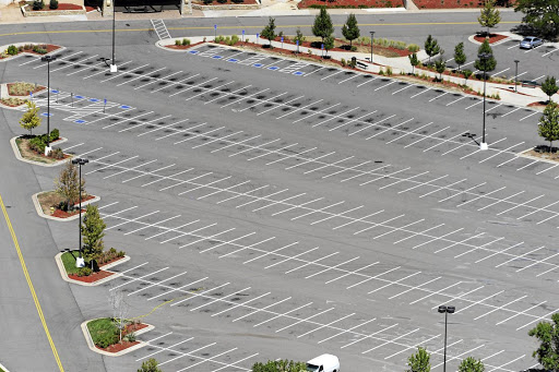 Empty mall parking lots mean fewer customers and staff retrenchments.  Picture:  Getty Images