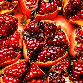 Fresh Red Pomegranates Split open by James Morris - Food & Drink Fruits & Vegetables ( red, fruits, fruit, pomegranates, exotic, fresh red pomegranates, fresh )