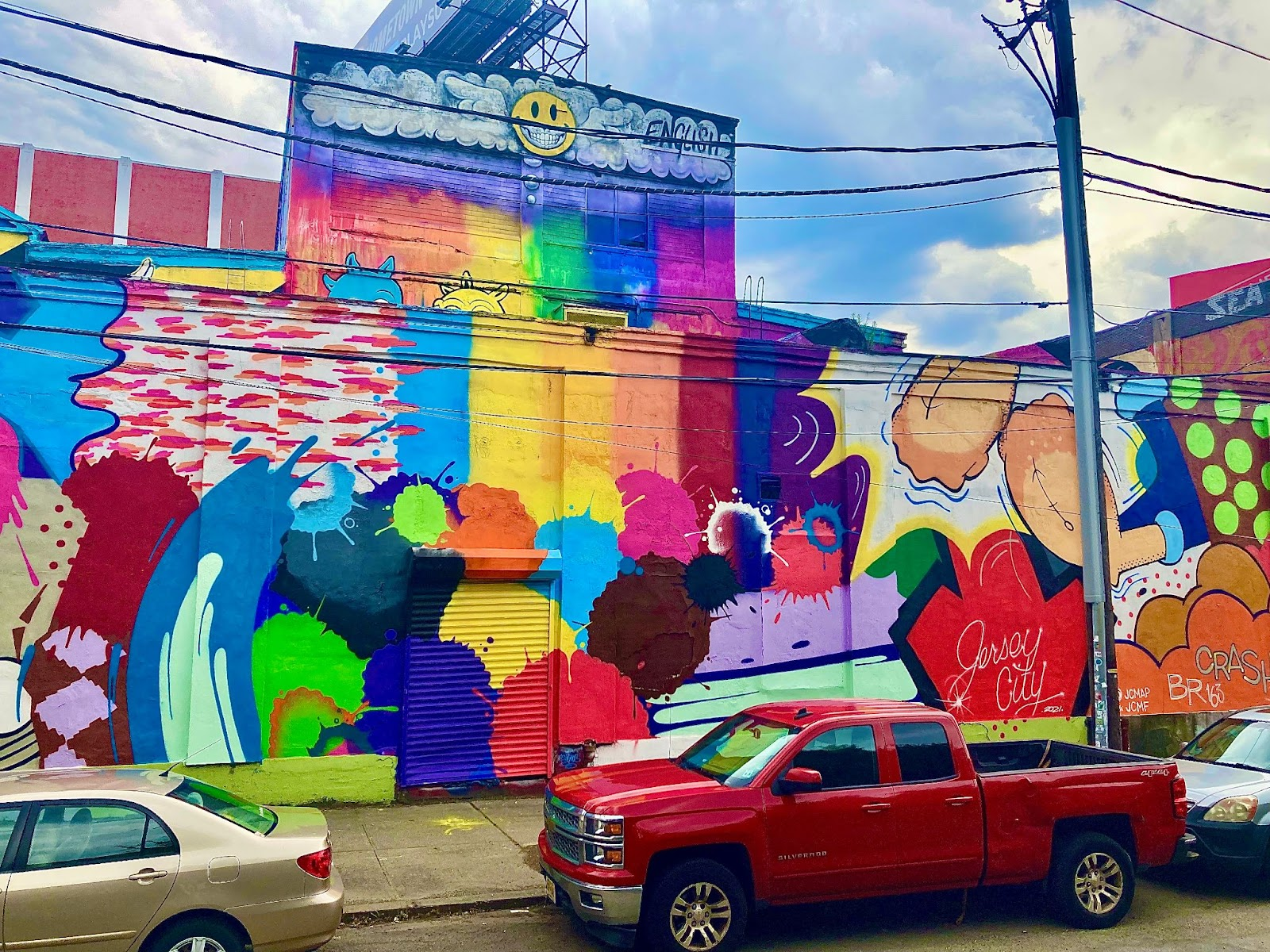Inside Look at Jersey City's Burgeoning Street Art. Mural by John CRASH Matos, with art by Ron English in the background. Monmouth St. & 13th St. Photo by Vittoria Benzine.