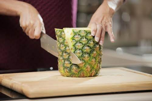 Step 2. Carefully cut the skin off the pineapple.