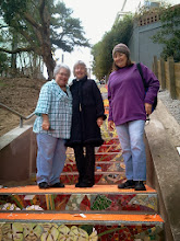 Photo: Hidden Garden Steps (16th Avenue, between Kirkham and Lawton streets in San Francisco's Inner Sunset District) organizing committee members and other volunteers (left to right: Debbie Herzfeld, Barbara Meli, and Connie Ngarangad) , on Saturday, November 2, 2013, had their first onsite visit as installation of the 148-step ceramic-tile mosaic designed and created by project artists Aileen Barr and Colette Crutcher continued. For more information about this volunteer-driven community-based project supported by the San Francisco Parks Alliance, the San Francisco Department of Public Works Street Parks Program, and hundreds of individual donors, please visit our website at http://hiddengardensteps.org.