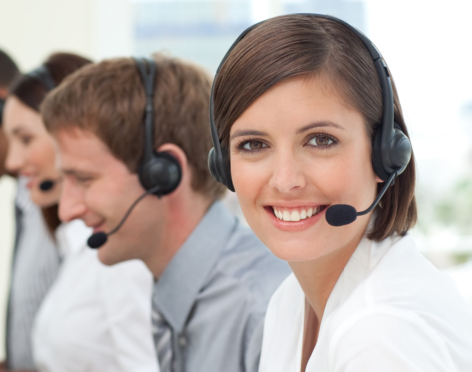 Smiling woman with a headset on.