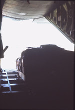 Photo: Unloading gear from a C130 at Butterworth, (Feb 1968)