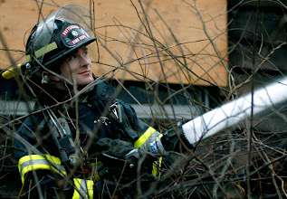 Photo: Norm Cummings SPECTRUM/Firefighter ? Riley of Patterson, N.Y. with hose at Jan. 13, 2007 drill at Mill Pond in Sherman