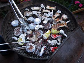 Photo: grilling the coconut-milk-dipped mushrooms and peppers over hot mesquite charcoal