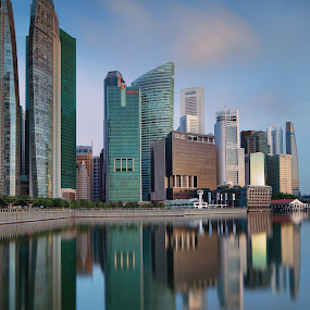 Symmetry by Richard Amar - City,  Street & Park  Skylines ( lee big stopper, reflections, canon eos 5d mark iii, marina bay, singapore, canon gps receiver gp-e2, canon ts-e24mm f/3.5l ii, buildings, long exposure, symmetry, singh ray lb warming polarizer, pwcskylines, central business district )