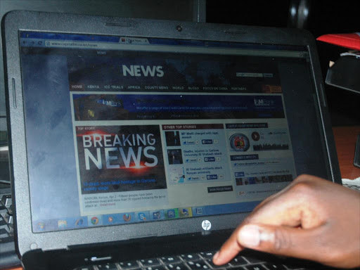 A reader follows the news on the internet in Kenya. /FILE