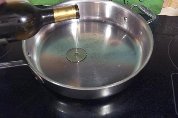 Add a tablespoon or two of grapeseed oil to a large skillet or sauté...