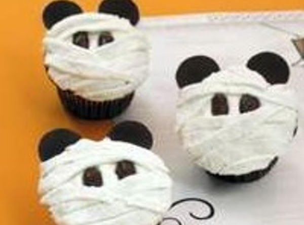 Mummy cup cakes using a flat nossle make bandages two eyes are either chips up side...