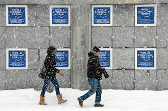 Photo: People walk in deep snow near the congress centre, venue of the upcomming Annual Meeting of the World Economic Forum in Davos, Switzerland, January 21, 2012.  World Econoomic Forum/swiss-image.ch/Photo Nadja Simmen
