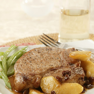 Thick Pork Chops with Spiced Apples and Raisins.