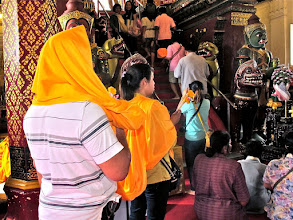 Photo: small groups of worshippers with holy cloth enter the chedi's chapel and climb the stairs up to the chedi