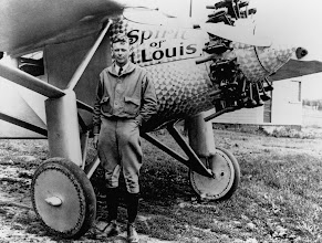 Photo: 31 May 1927 --- A portrait of Charles Lindbergh as he stands with his monoplane <Spirit of St. Louis> ten days after his solo flight over the Atlantic Ocean in May 1927. --- Image by © Bettmann/CORBIS