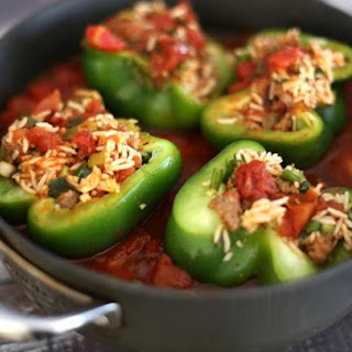 Pork Steaks With Rice and Sausage Stuffed Peppers