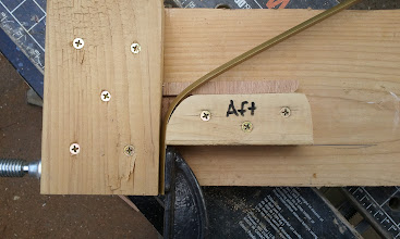 Photo: A quick and dirty jig for bending the half oval for the hull rub strips/runners.