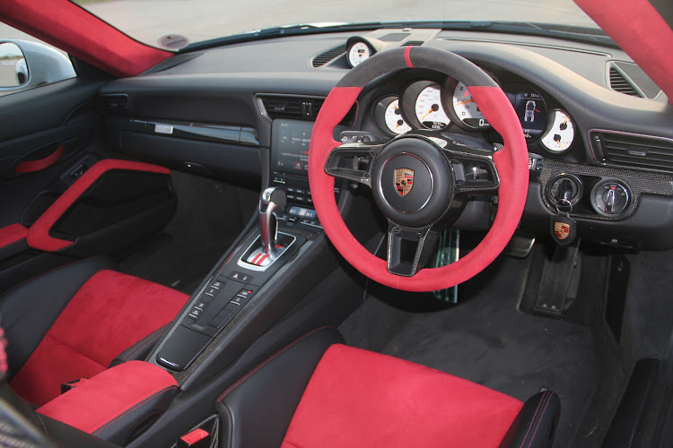 Race-inspired two-seater cockpit has full bucket seats and an alcantara-clad steering wheel.
