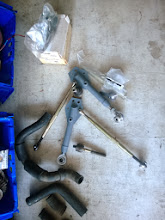 Photo: spare front control arms, balljoints, radiator hoses, tie rod end.