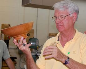 Photo: Gary points out the base on this cherry bowl.