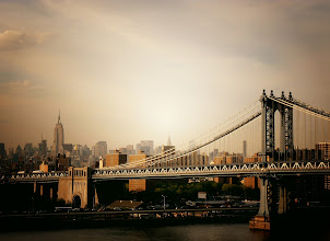 """Photo: """"My journey...""""  The New York City skyline featuring the Manhattan Bridge as seen from the Brooklyn Bridge. New York City.  I am in an exceptionally great mood today. Tonight, I am attending the first ever gallery showing of my photography. It's a group show with three other photographers and a private event where 8 of my photos will be on display. I will post all about it over the next few days (with photos of course). I also just got back from the orthopedic specialist who gave me the go ahead to abandon my crutches (from my bike accident a week ago). While I am still dealing with a ligament tear, I am thrilled that I can just wear my knee brace to the event tonight!  In honor of today, I am re-posting this post from a few months back. It's about my photography origins and it makes me well up with tears when I read it because it feels like I have come so very far in a relatively short amount of time. It's been a bumpy road full of challenges and road-blocks but it's also been one hell of an adventure.  It seems fitting to post today somehow. I am so thankful for everyone here and all the wonderful people who I met and friended on this wild journey. I can only hope that the years to come will be just as challenging, inspiring and full of brilliant moments like the ones I have had the pleasure to experience. Enjoy :)  —-  I started taking photos a few years back in a rather stream of consciousness manner. I don't drive since I live in New York City and without much in the way of material things or financial prosperity walking became a way to deal with stress. It also became the main way to experience New York City in a way I hadn't experienced the city before. I would choose a direction and walk as far as my feet would take me (I still do this). I started noticing lines, forms and structures I had previously ignored. Scenery unfolded before me as if it was just rendered before my eyes.  To embrace my new-found sense of wonder, I decided to take the only camer"""