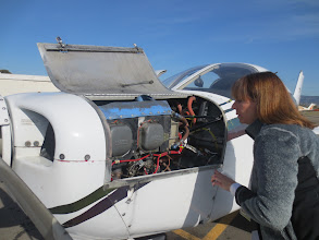 Photo: Pre-flight check of the Piper