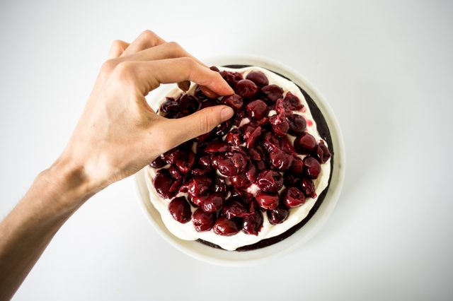 Arrange the cherries on top of the cream.