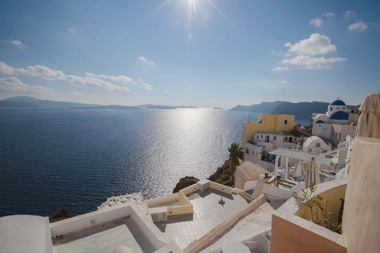Overlooking the sugarcube houses and shimmering bay in Oia on the Greek island of Santorini.