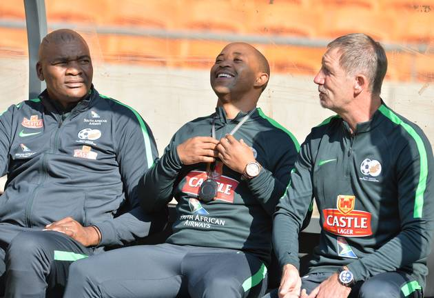 Bafana Bafana head coach Stuart Baxter (R) shares a light moment with his assistants Thabo Senong (M) and Molefi Ntseki (L) during the South African national men's soccer team training session at FNB Stadium on June 06, 2017 in Johannesburg, South Africa.