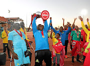 Sundowns coach Pitso Mosimane celebrates victory with players  after the side beat Free State Stars at Goble Park Stadium in Bethlehem, securing the premiership title.