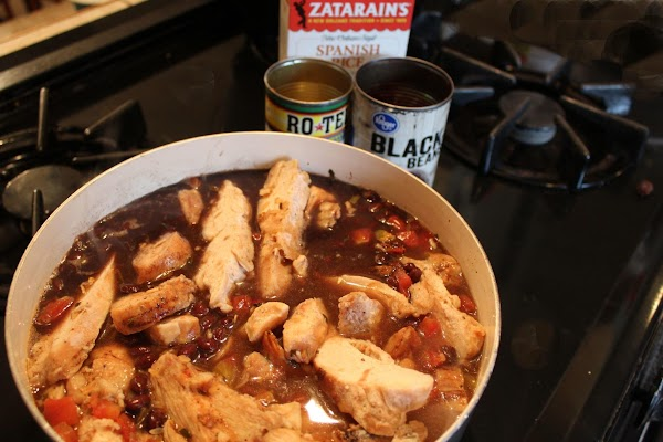 Combine all ingredients (chicken broth, butter, Rotel chopped tomatoes, black beans, chicken and Zatarain's...