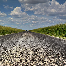 country road by Fraya Replinger - Transportation Roads ( clouds, sky, asphalt, blue, grass, road, country )