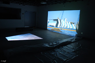 """Photo: Projection of """"Concordia,"""" hd two channel video, 8 min. trt (loop), with pvc tube and plastic sheet, UofC DoVA MFA critique 11/20/12. mgfi"""