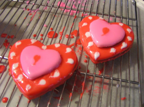 Let the glaze firm up enough to handle, then gently slide the small heart...