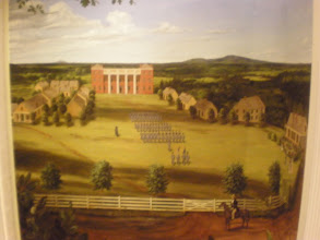 Photo: painted on the wall next to cannon - depicts the campus back in the time of the institute