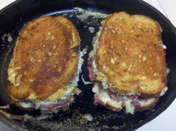 add additional 1/4 stick butter, melt and flip sandwiches onto melted butter. again cook...