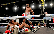 Michael Mokoena knocks down Lusanda Komanisi in the fourth round of the ABU lightweight title during the Call for Glory boxing event at Emperors Palace in Kempton Park on Saturday night.