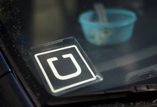 An Uber car is seen parked with the driver's lunch left on the dashboard. File Photo