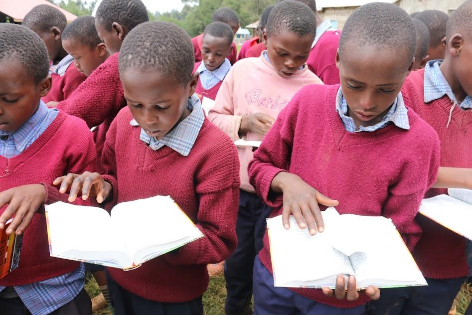 Displaying MEKARO PS PUPILS READING THE BIBLE.JPG