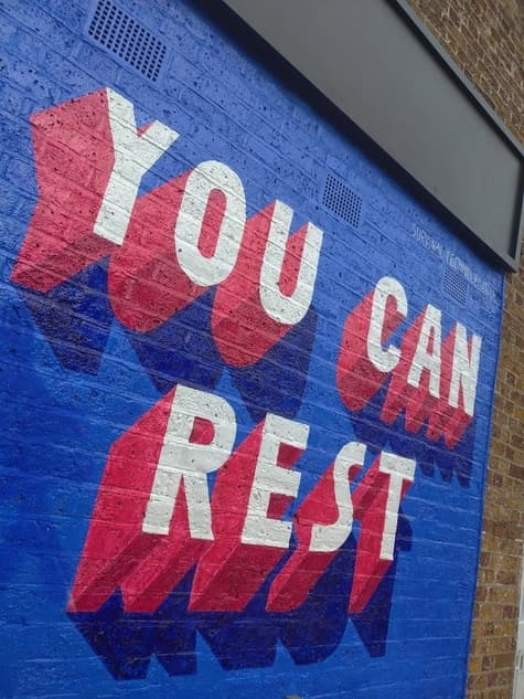 'You can rest' big and bold on a wall