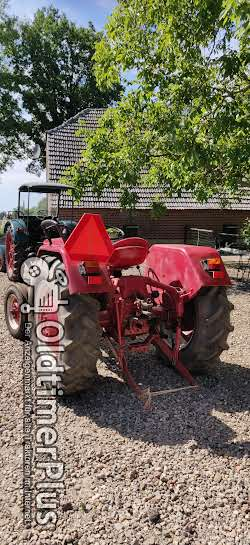 IHC 324 nette tractor Foto 3