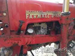 IHC Mc Cormick D324 met schepbak Foto 6