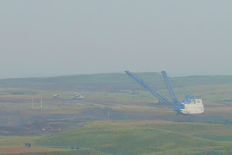 Photo: I took this photo of the massive electric-powered shovel in the lignite mine later in the day, from the top of the adjacent power plant, hence the haziness. The mine supplies lignite for both the power plant and the coal gassification plant.