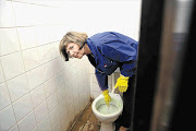 NOT JUST A METAPHOR: Gauteng MEC for education Barbara Creecy cleaning a toilet at an East Rand school. The province's schools re-open on Wednesday