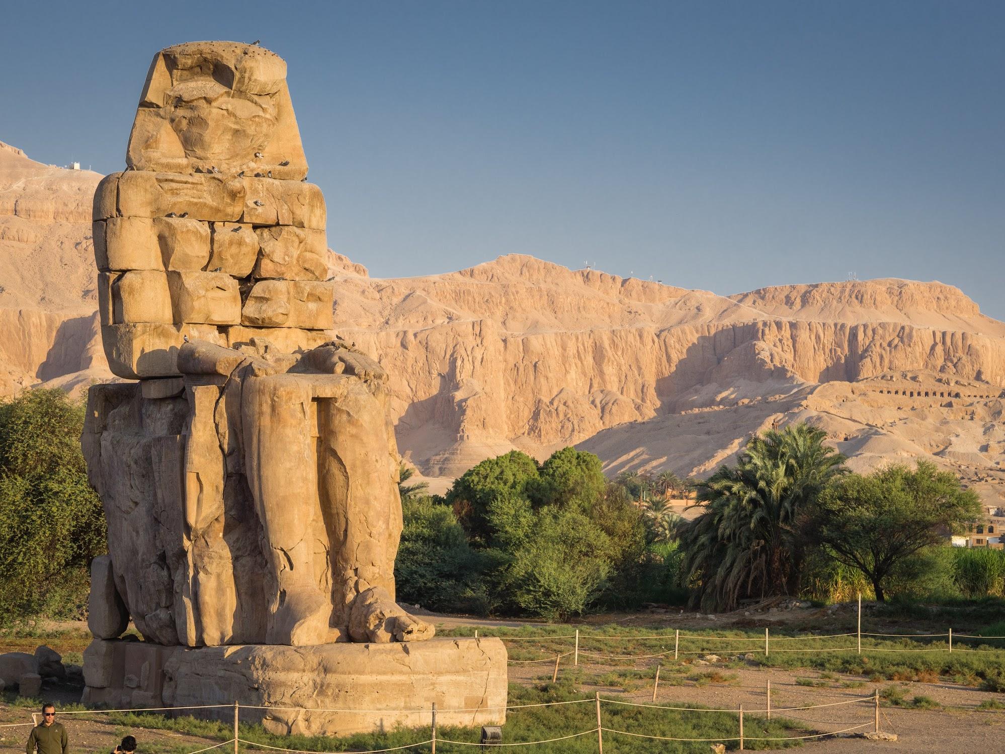 Colossi of Memnon against the desert mountain in Luxor