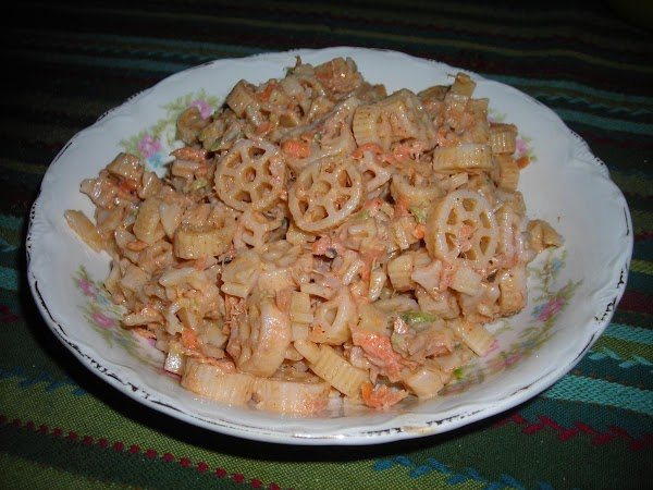 add the tuna and fold into the dressing, next fold in the pasta, transfer...
