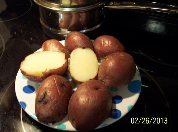 Wash and  pre-boil potatoes. Till a fork goes gently into themLet cool, put...