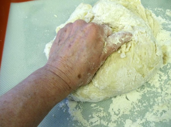 KNEAD until dough becomes smooth and elastic. Place in lightly greased bowl. Grease top...