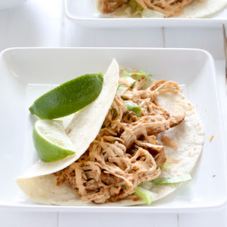 Easy Slow Cooker Chicken Tacos with Chipotle Sour Cream Sauce.