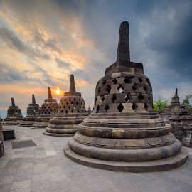 Borobudur Stupas by Andy Prasetyo - Buildings & Architecture Public & Historical ( architecture, landscape, historic, sun, borobudur, indonesia, sunsets, buildings, cloudy, sunshine, golden hour, clouds, building, hdr, architectural detail, high dynamic range, history, temple, landmark, landmarks, sunset, landscape photography, architectural, cloud, historical, sunrise, landscapes )